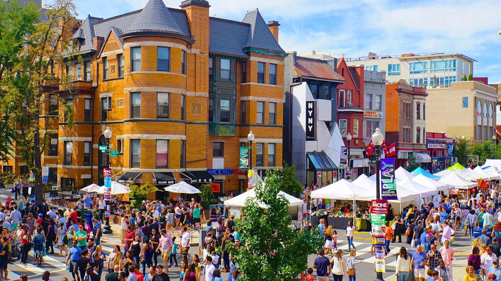 Photo of an outdoor festival in the Washington D.C. neighborhhood of Adams Morgan—a culturally diverse neighborhood in Northwest Washington, D.C., centered at the intersection of 18th Street and Columbia Road