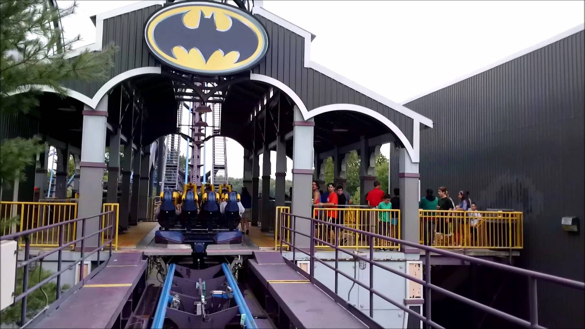 A Photo of the Six Flag New England's Batman: The Dark Knight roller coaster ride as eager riders await to get aboard. Batman: The Dark Knight (formerly known as Batman: The Ride) is a steel floorless roller coaster designed by Bolliger & Mabillard located in the south end of Six Flags New England. The roller coaster has 2,600 feet (790 m) of track, reaches a maximum height of 117.8 feet (35.9 m), and features five inversions. The coaster was announced on February 6, 2002 and opened to the public on April 20, 2002. In 2008, the ride's name was changed to Batman: The Ride to avoid confusion with The Dark Knight Coaster that was planned to be built at the park; after the project was cancelled, the ride's name reverted to its original.
