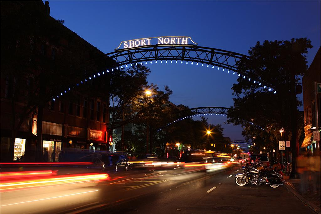 A nightime photo of the Short North Arches, centered on the main strip of High Street immediately north of downtown Columbus Ohio and extending until just south of the Ohio State University campus area. It is an easy walk from the convention center or Nationwide Arena district to the north. The Short North is often crowded on weekends, particularly during the monthly