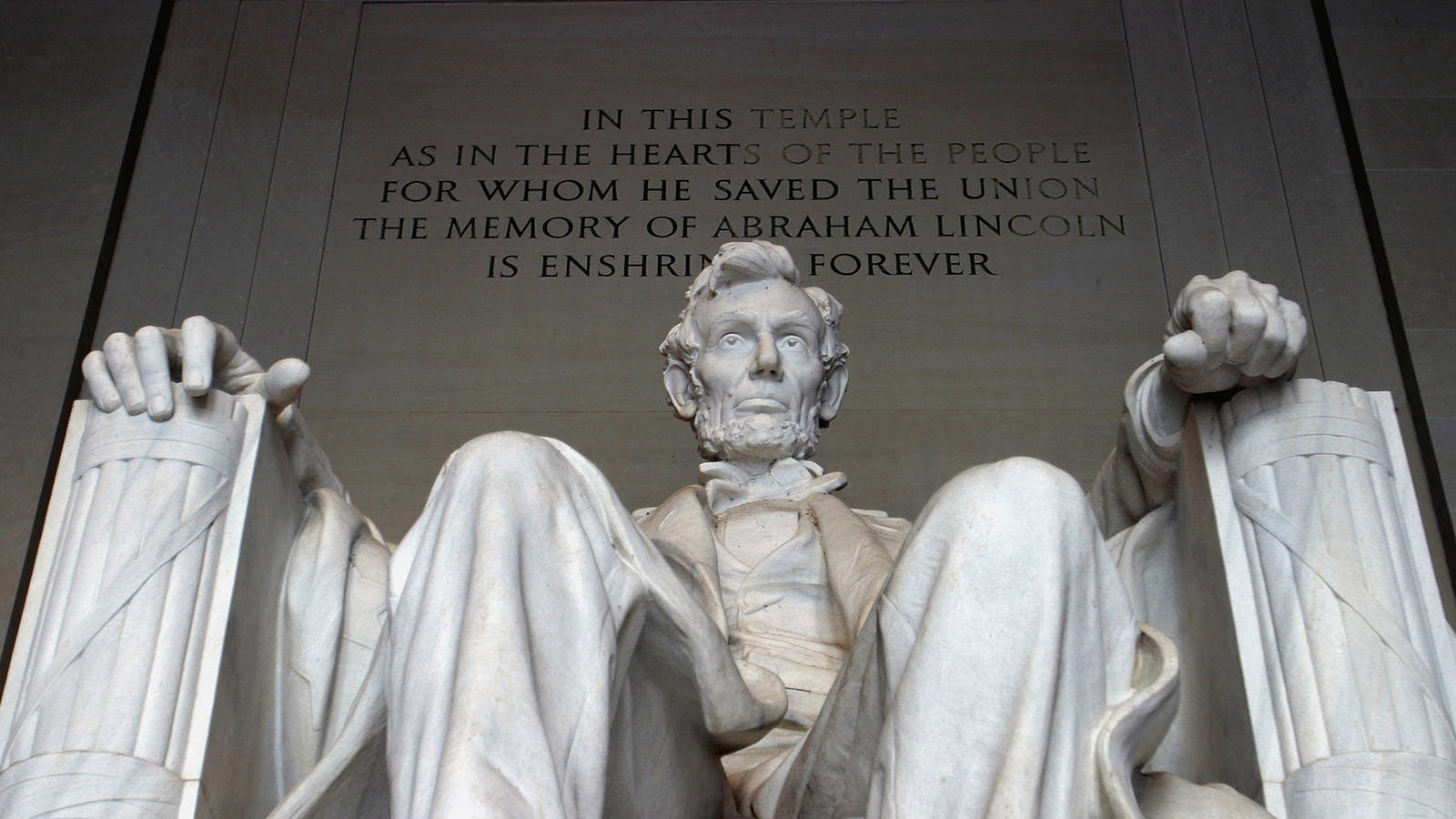 Photo of the Lincoln Memorial. The Lincoln Memorial is an American national monument built to honor the 16th President of the United States, Abraham Lincoln. It is located on the western end of the National Mall in Washington, D.C., across from the Washington Monument. The architect was Henry Bacon; the designer of the primary statue – Abraham Lincoln, 1920 – was Daniel Chester French; the Lincoln statue was carved by the Piccirilli Brothers;[2] and the painter of the interior murals was Jules Guerin. Dedicated in 1922, it is one of several monuments built to honor an American president. It has always been a major tourist attraction and since the 1930s has been a symbolic center focused on race relations.