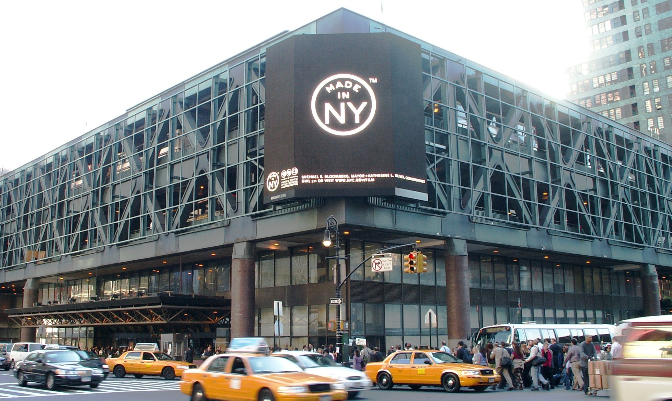 A photo of New York's Port Authority Bus Terminal. The Port Authority Bus Terminal (PABT) is the main gateway for interstate buses into Manhattan in New York City. It is owned and operated by the Port Authority of New York and New Jersey (PANYNJ). Colloquially called the Port Authority, the bus terminal is located in Midtown at 625 Eighth Avenue between 40th Street and 42nd Street, one block east of the Lincoln Tunnel and one block west of Times Square. The PABT, opened in 1950 between 8th and 9th Avenues and 40th and 41st Streets, was built to consolidate the many different private terminals spread across Midtown Manhattan. A second wing extending to 42nd Street was added in 1979. It is one of three bus terminals operated by the PANYNJ, the others being the George Washington Bridge Bus Station in Upper Manhattan and the Journal Square Transportation Center in Jersey City.
