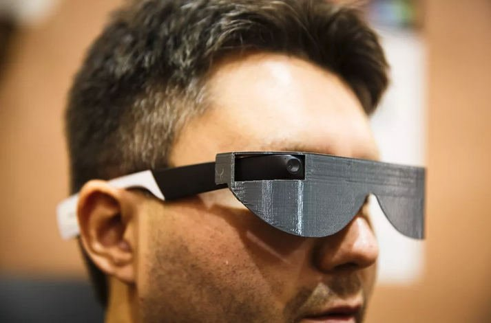 Photo of a man wearing Aira glasses. Aira, a US-based startup, has developed a pair of smart glasses that can help blind people with everyday tasks. The glasses, which are based on Google Glass, connect blind customers with a network of certified agents that can see what the blind person would be seeing in real time.
