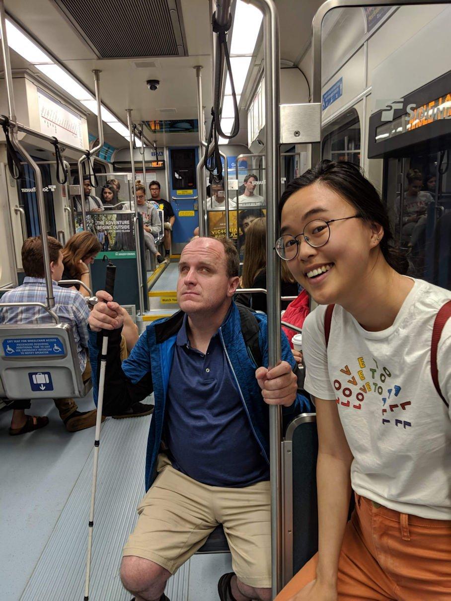 A photo of Ian and friend Stephanie on the Seattle Light Rail train