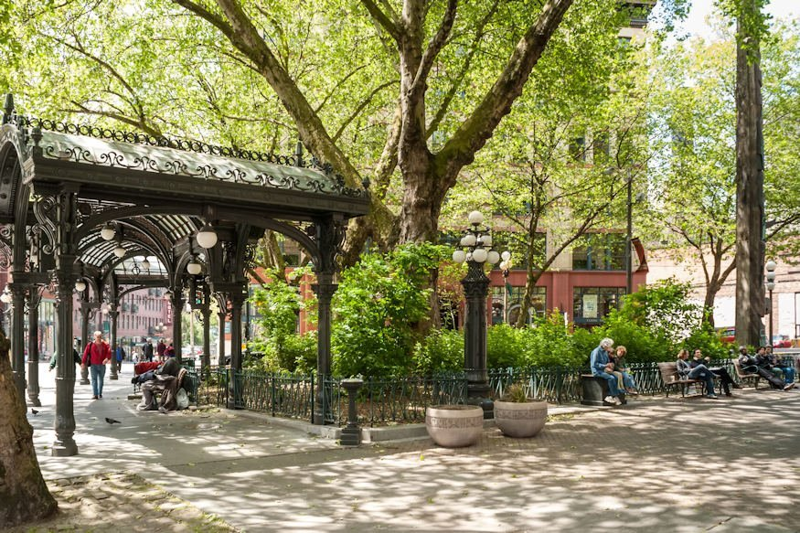 A photo of trees and park bench in Pioneer Square. Pioneer Square is a neighborhood in the southwest corner of Downtown Seattle, Washington, USA. It was once the heart of the city: Seattle's founders settled there in 1852, following a brief six-month settlement at Alki Point on the far side of Elliott Bay.