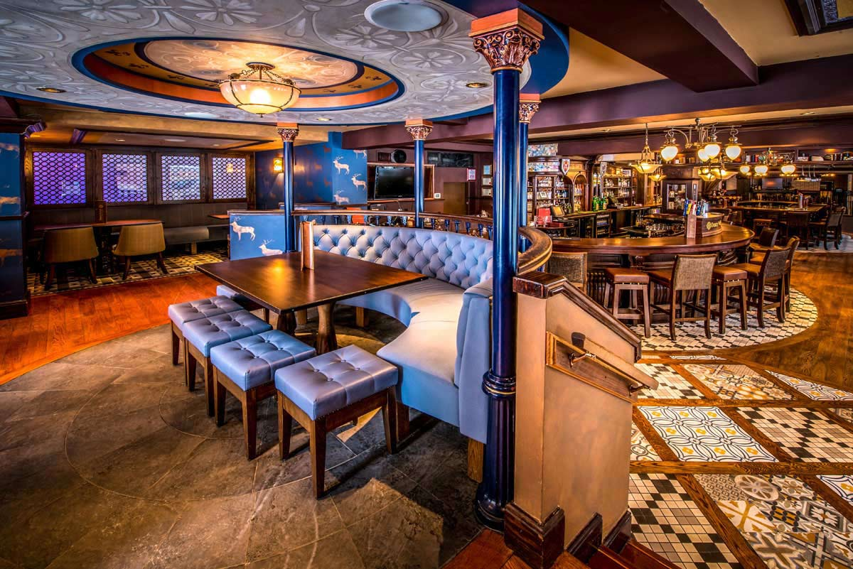 "Interior photo of the elegant Durty Nelly's Authentic Irish Pub. Durty Nelly's is a legendary establishment named after a famous Irish hostess and entrepreneur, built in the shadow of the 15th century Bunratty Castle.  Today, it is also one of Ireland's most famous landmarks for its food and hospitality. It is what the Irish like to call ""craic agus ceoll"" and it is an experience that we have recreated here on the corner of Argyle and Sackville in downtown Halifax, Nova Scotia."