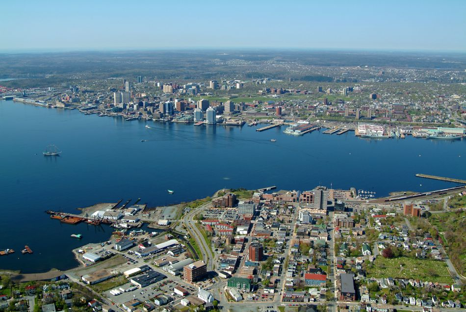 Aerial photo of Halifax, Novia Scotia. Located on the southern shore of Nova Scotia, Halifax is the largest city in Canada's Atlantic Ocean region and one of the country's most popular destinations. Halifax boasts one of the world's largest harbours,  which played a critical role in the country's economic and military history. The star-shaped citadel, built to protect the city, still sits high on a hilltop, commanding a striking presence over the city.